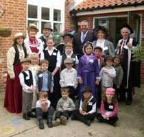 IMAGE: Richard Bacon MP with pupils, staff and governors at Brockdish Primary School Victorian Open Day