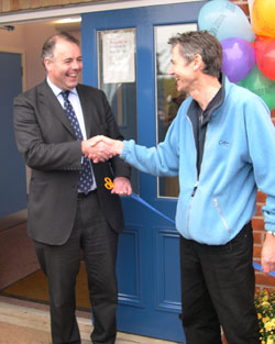 Richard Bacon MP and headteacher Ken Holbeck shake hands after Richard declared the new extension open