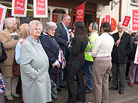 Mr Bacon joins campaigners outside Trowse Post Office and Stores