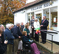 Richard Bacon MP (right) prepares to cut the ribbon on the refurbished Bressingham village shop