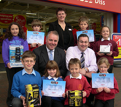 Richard Bacon MP (second row left) with pupils from Bressingham Primary, Diss Junior, Roydon Primary and Scole Primary and Tesco Store Manager Alistair Wilson (second row right) and Tesco Personnel Manager Amanda Bushell (top row centre)