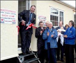 Richard Bacon MP officially opens Masterman Park Homes' show home,  watched by guests, including Neil Masterman and Peter Fox, managing director of Omar Homes.