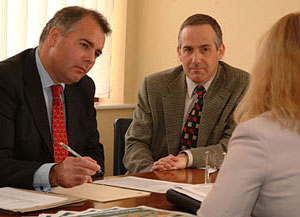 South Norfolk MP Richard Bacon (left) helps a constituent while Principal of Easton College, David Lawrence (centre) looks on.